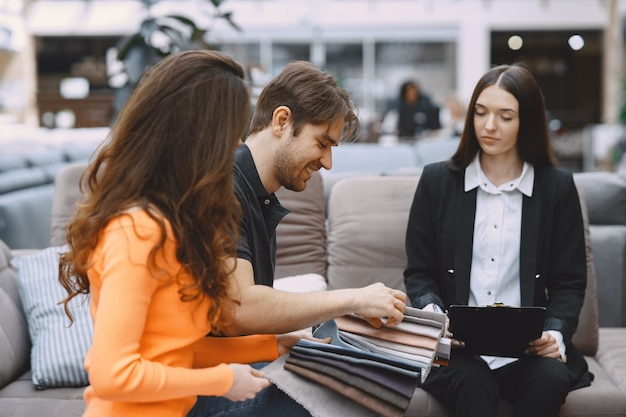 Couple choosing fabric in furniture store