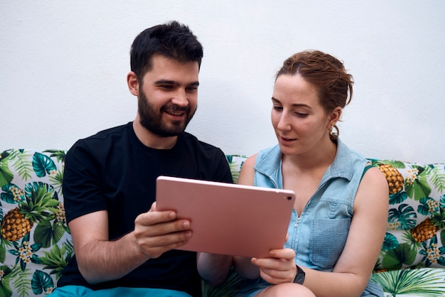 Couple choosing a holiday destination using a tablet