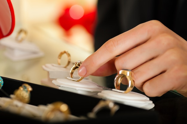 Couple choosing a ring at the jeweller