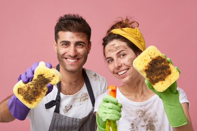 Couple cleaning everything in their apartment