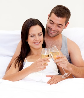 Couple clebraitn their love with champagne