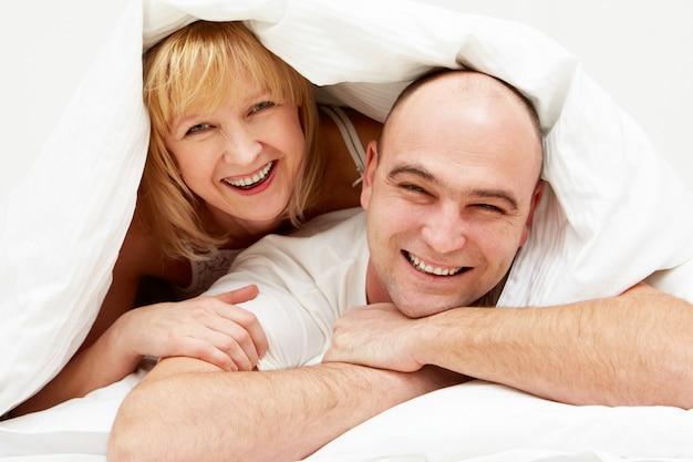 Couple comfort blanket family man