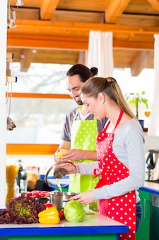 Couple cooking in domestic kitchen healthy food