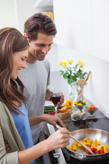 Couple cooking together vegetables