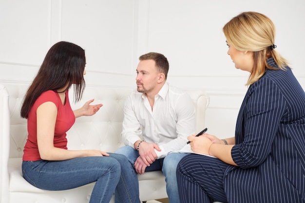 Couple counseling concept. disappointed in marriage wife complaining on husband sitting on couch