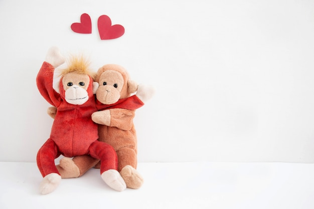 Couple cute monkey with red heart balloons