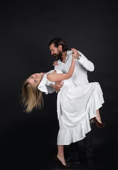Couple dancing passion and love concept dancing salsa tangoing waltz couple in tender passion