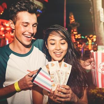 Couple dating amusement park enjoyment hugging concept