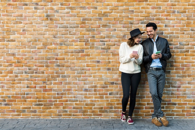Couple dating happiness traveling using smart phone