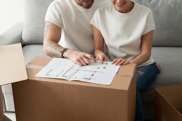 Couple discussing house plan, moving in new home, planning renovation