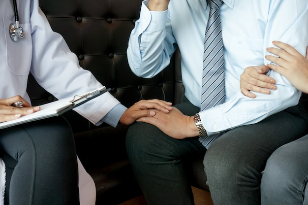 Couple discussing problems with psychiatrist and relationship counselor.