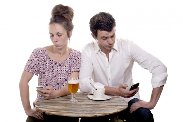 Couple disgruntled at the terrace of a cafe