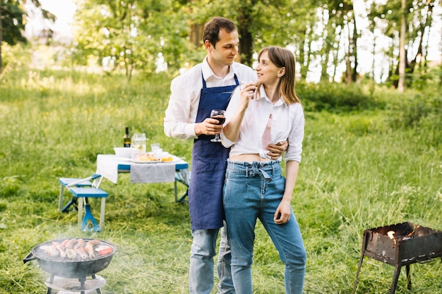 Couple doing a barbecue in nature