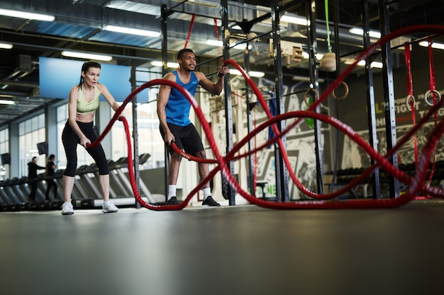Couple doing battle ropes exercise