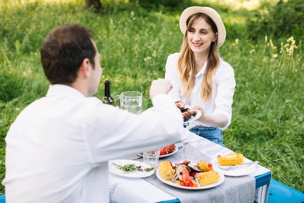 Couple doing a romantic picnic in nature