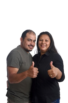 Couple doing the sign thumbs up on white background