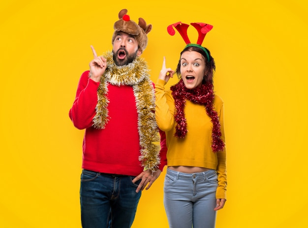 Couple dressed up for the christmas holidays intending to realizes the solution