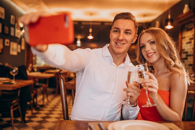 Couple drinking champaigne at a restaurant on valentines day