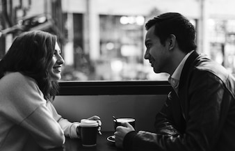 Couple drinking coffee at a cafe
