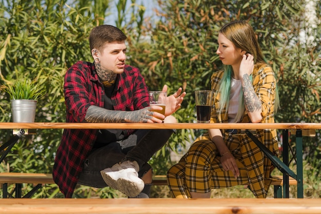 Couple drinking craft beer outdoors