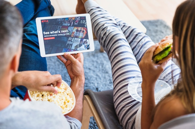 Couple eating and browsing netflix site