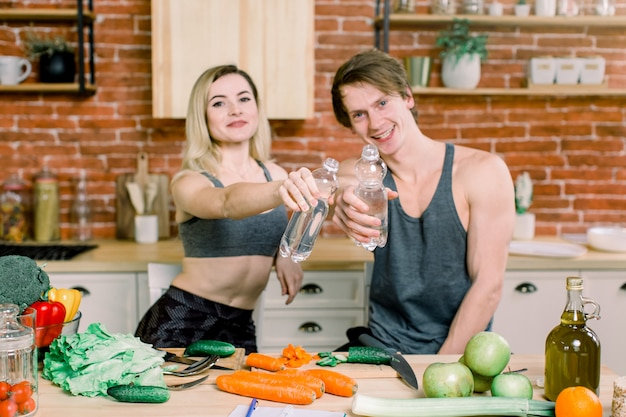 Couple eating food feeding sweet concept. a happy couple is preparing food in the kitchen and drinking water
