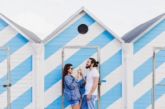 Couple eating ice cream at the beach