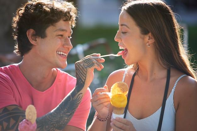 Couple eating ice cream while traveling