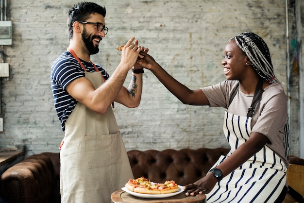 A couple eating pizza together