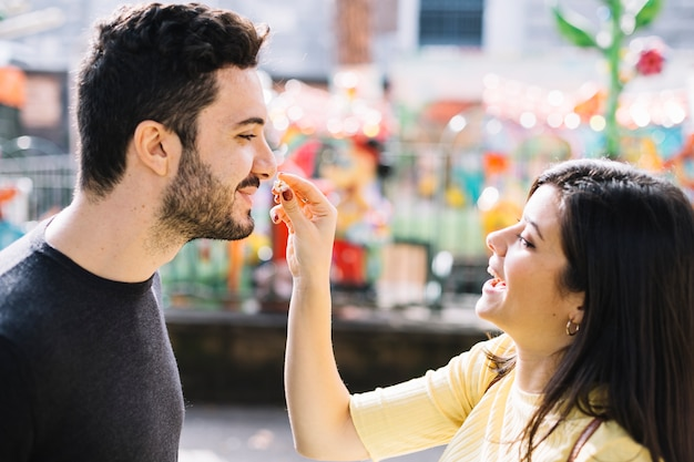 Couple eating popcorn in a theme park