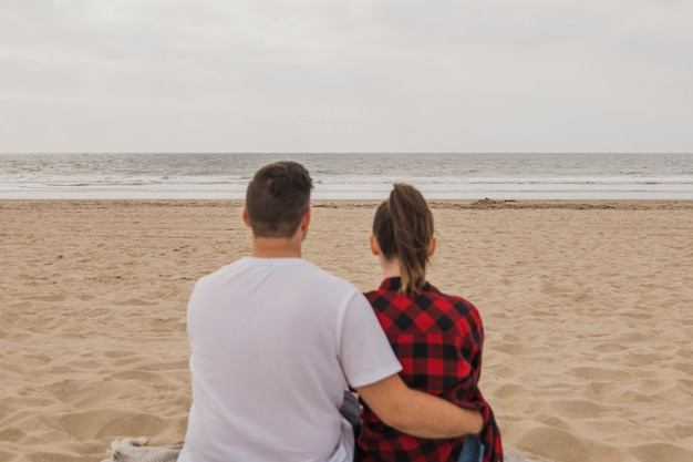 Couple embraced on beach