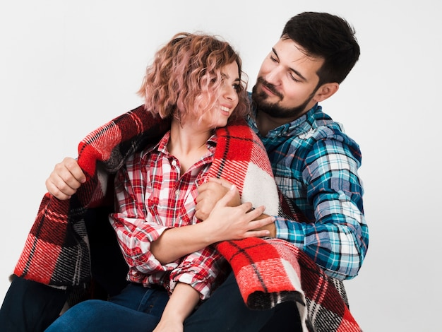 Couple embraced with blanket for valentines