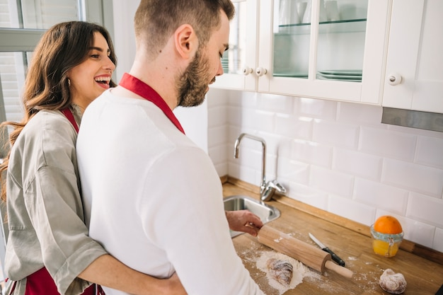Couple embracing and cooking