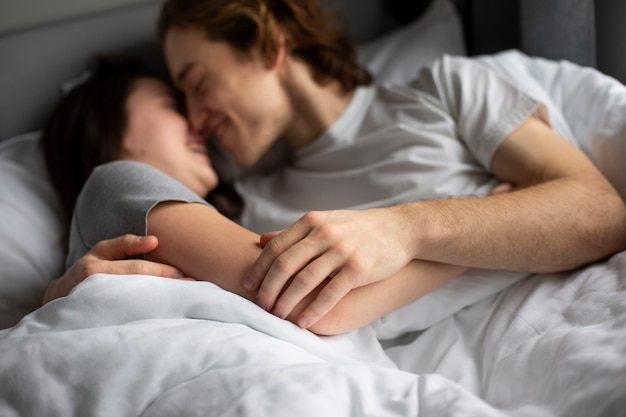 Couple embracing fondly while in bed