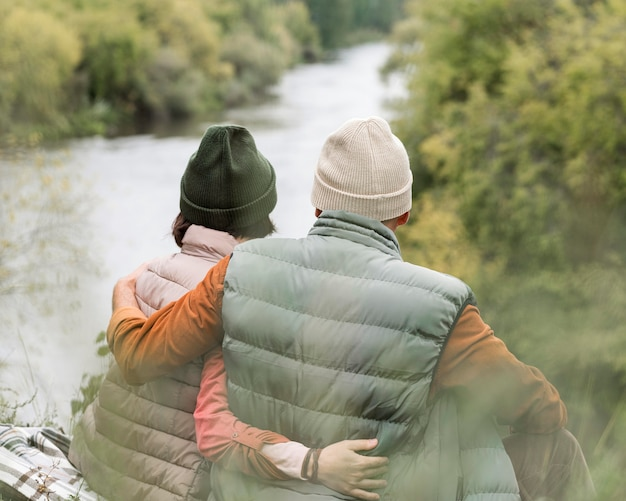 Couple embracing looking at river