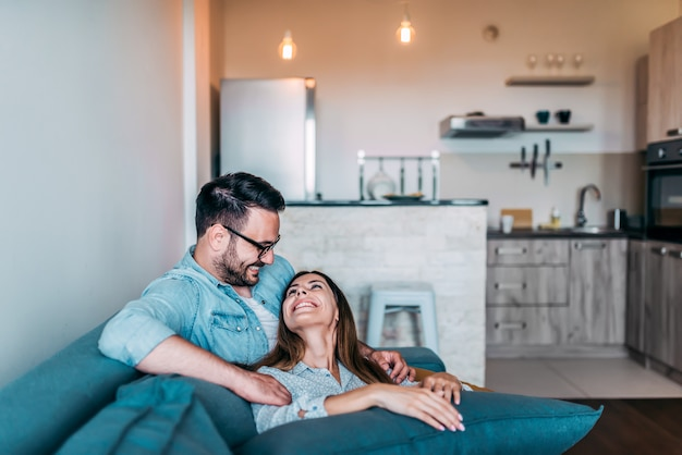 Couple enjoy spending time at home.