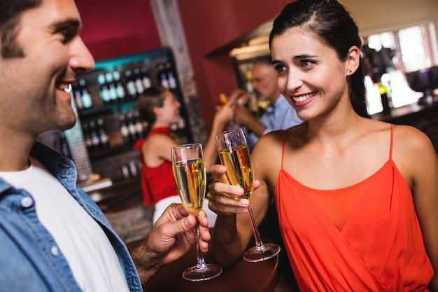 Couple enjoying champagne in nightclub