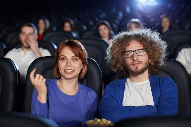 Couple enjoying date in movie theater.