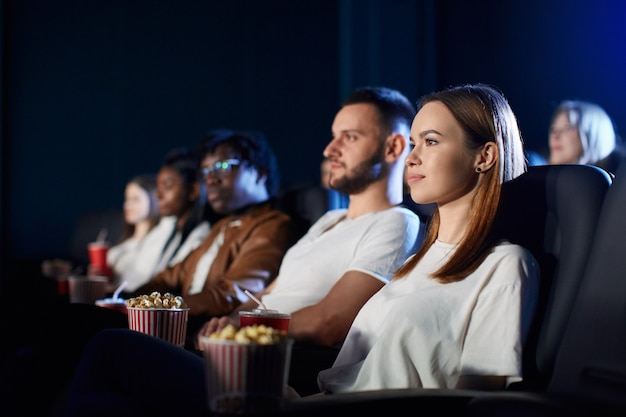 Couple enjoying free time in movie theater.