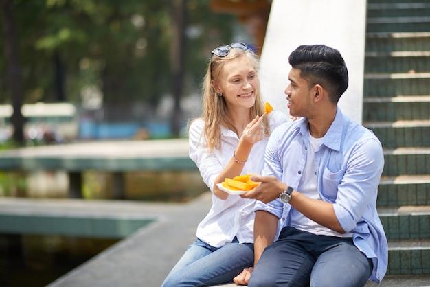 Couple enjoying papaya
