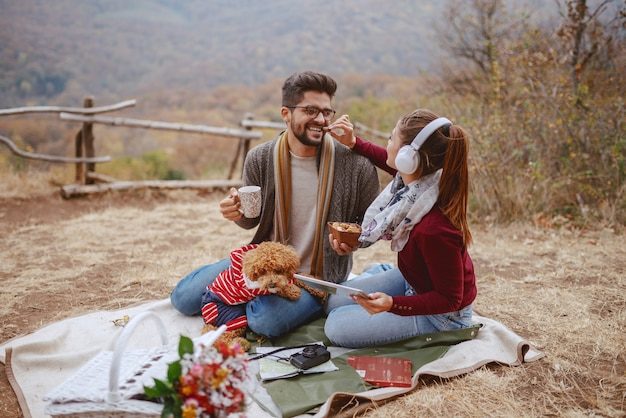 Couple enjoying picnic at autumn