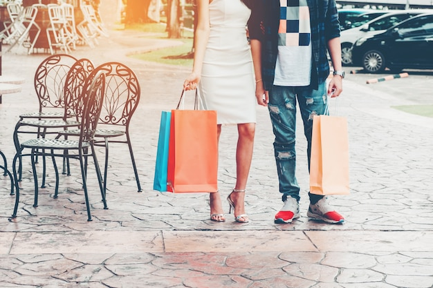 Couple enjoying romance spending shopping bags