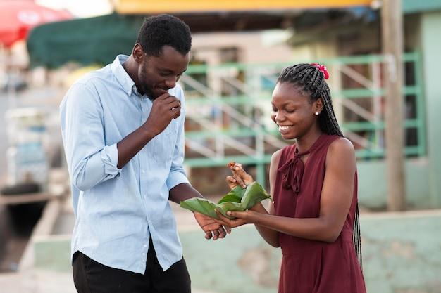 Couple enjoying some street food together