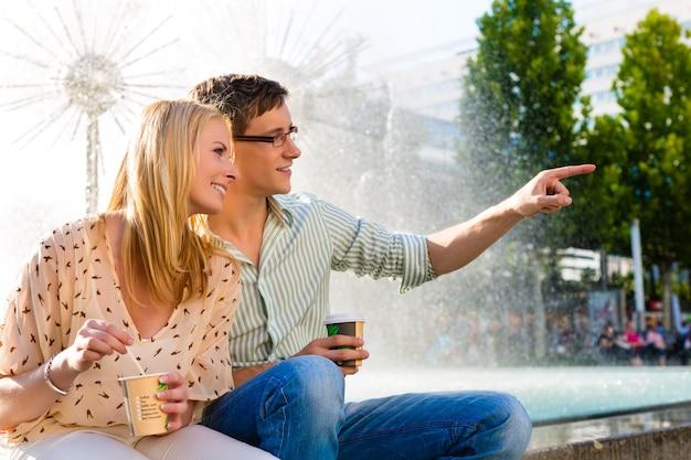 Couple enjoying take away coffee in a break
