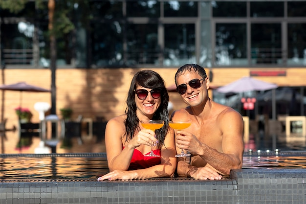 Couple enjoying their day at the swimming pool