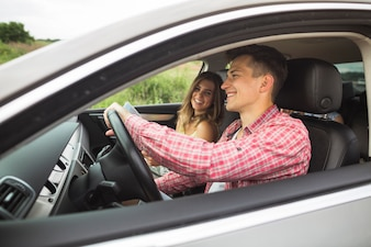 Couple enjoying travelling in the car