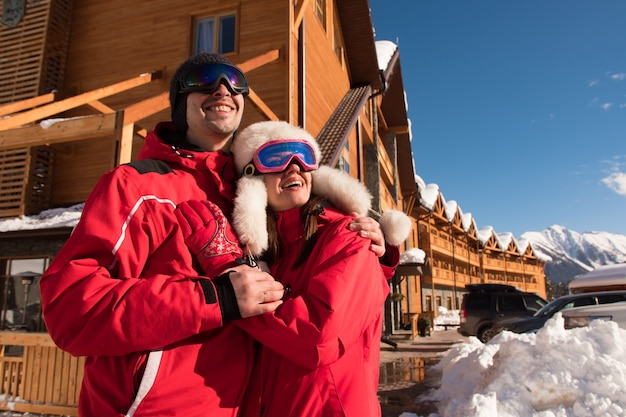 Couple enjoying view of cottages and chalets in a ski resort.