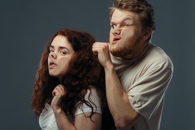 Couple faces crushed on glass, funny emotion