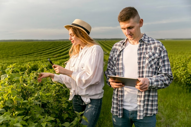 Couple at farm with tablet
