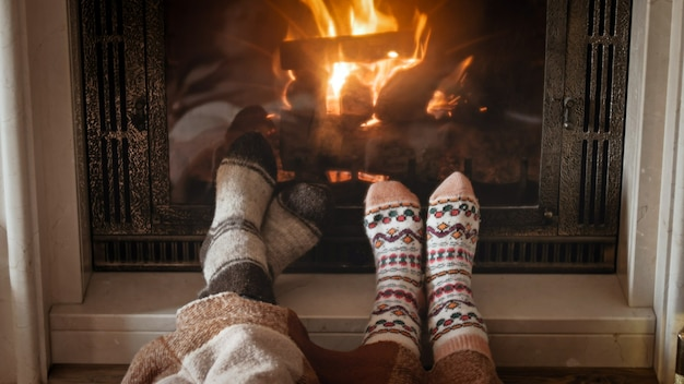 Couple feet lying by the fireplace